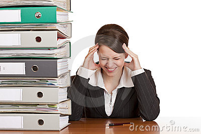 Business woman has migraine due to stress