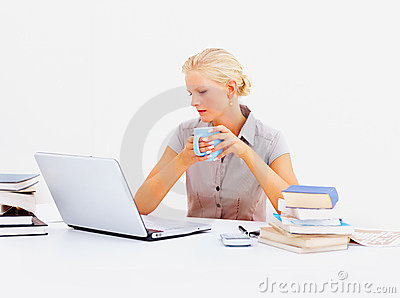 Business woman having coffee , at her desk at work