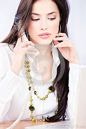Business woman having a telephone call