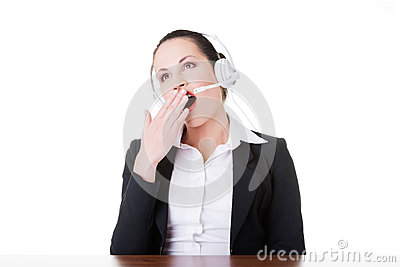Business woman with headphones yawning.