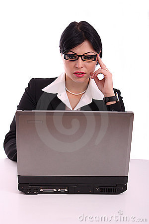 Business woman at her desk working  at computer