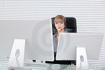 Business woman in her office with head phones