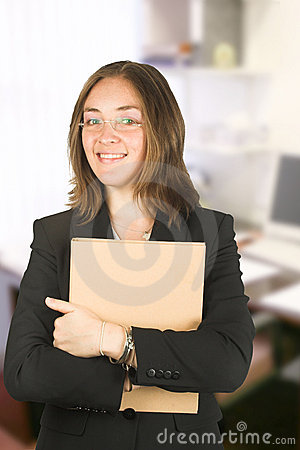 Business woman in her office holding a folder