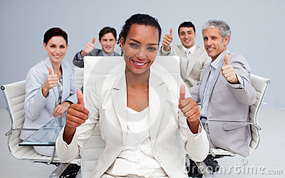 Business woman and her team with thumbs up