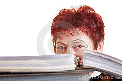 Business woman hiding behind files
