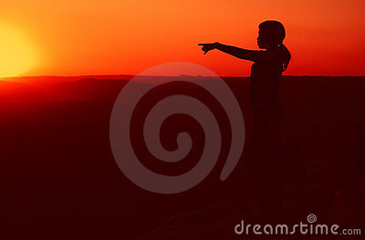 Business Woman on Hill top during Sunset