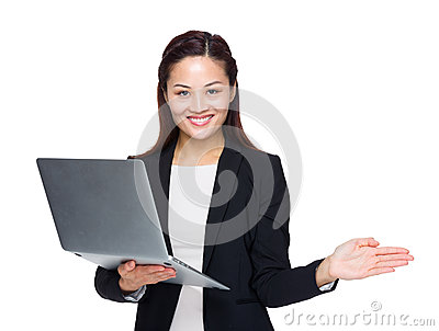Business woman hold laptop computer and open hand palm
