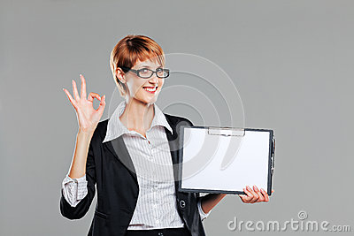 Business woman holding a clipboard and gesturing