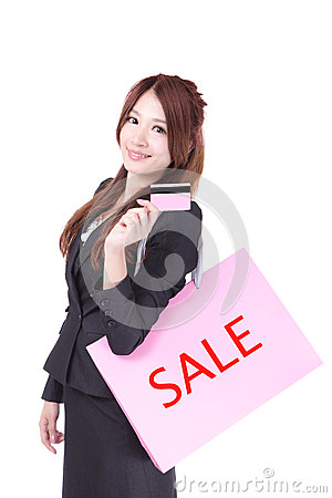 Business woman holding credit card and bag
