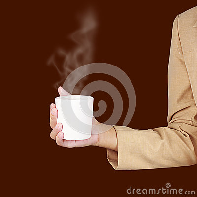 Business woman holding a cup of coffee