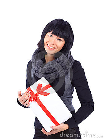 Business woman holding a gift isolated on white