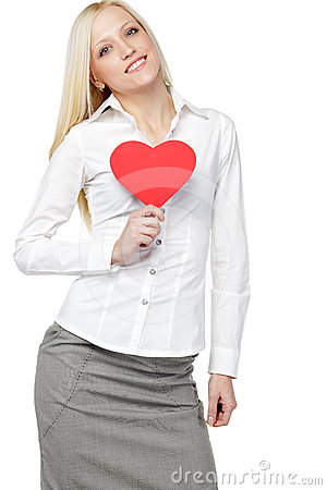 Business woman holding heart shape