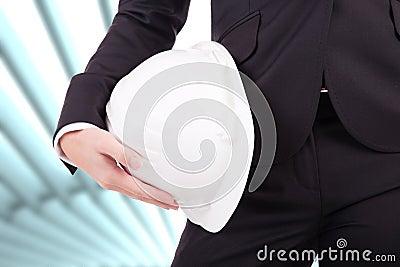 Business woman holding an helmet