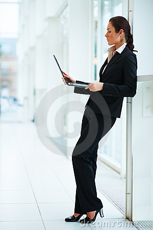 Business woman holding laptop with copy space