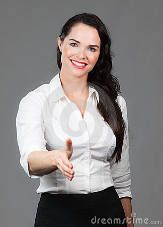 Business woman holding out hand