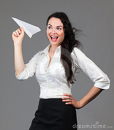 Business woman holding paper airplane