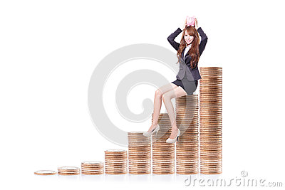 Business woman holding piggy bank with money stairs