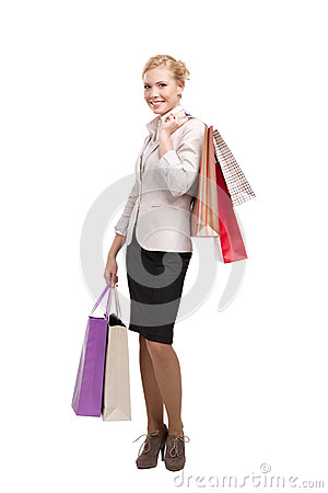 Business woman holding shopping bags