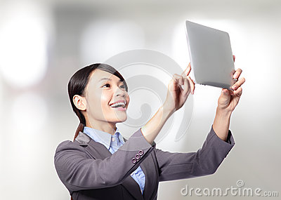 Business woman holding a tablet pc
