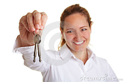 Business woman holding two keys
