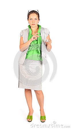 Business woman holds ashtray and smokes in studio