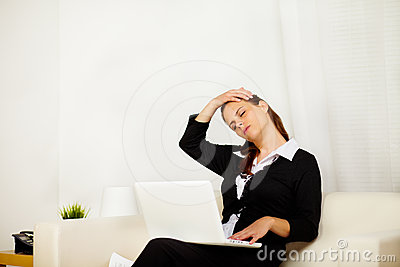 Business woman at home with neck pain