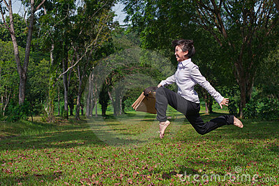 Business woman jump and dance outdoor