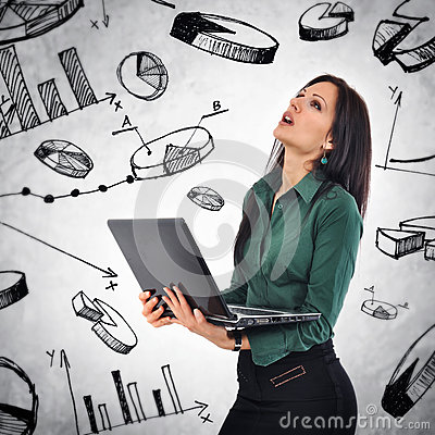 Business Woman with laptop computer analyzing infographics