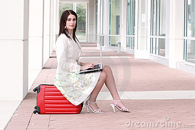 Business Woman with Laptop on the Go, Traveling