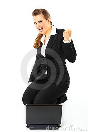 Business woman with laptop rejoicing her success