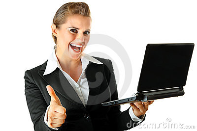 Business woman with laptop and showing thumbs up