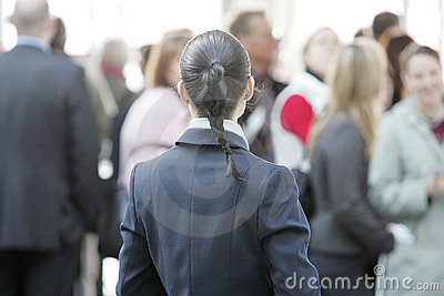 business woman with large group of people in the background