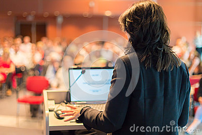 Business woman lecturing at Conference. Editorial Photo