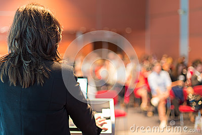 Business woman lecturing at Conference. Editorial Image