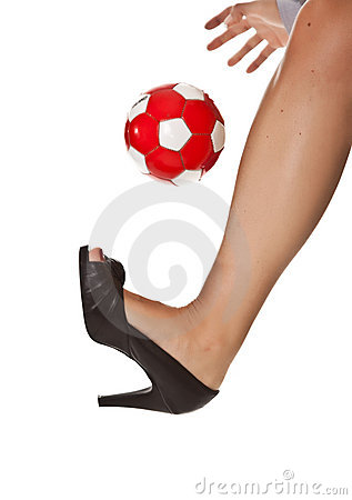 Business woman leg in high heel with soccer ball