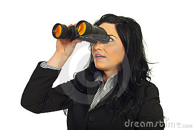 Business woman looking through binocular