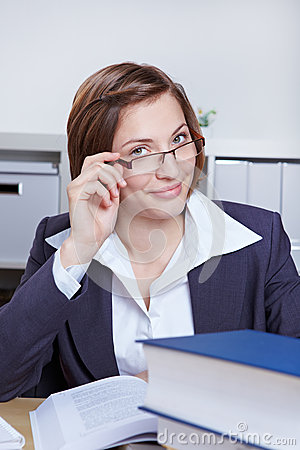 Business woman looking over rim of her glasses