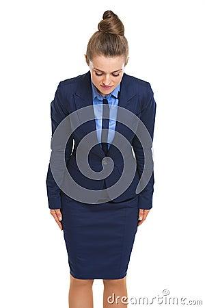 Business woman making asian greeting