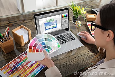 Business Woman Making Color Selection For Logo Design Stock Photo