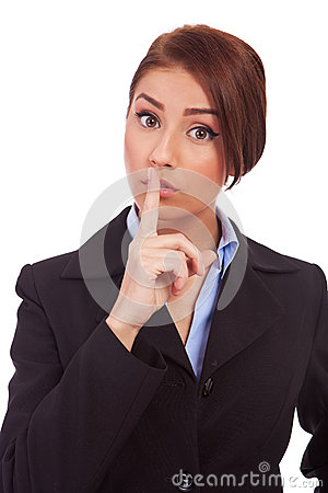 Business woman making quiet gesture
