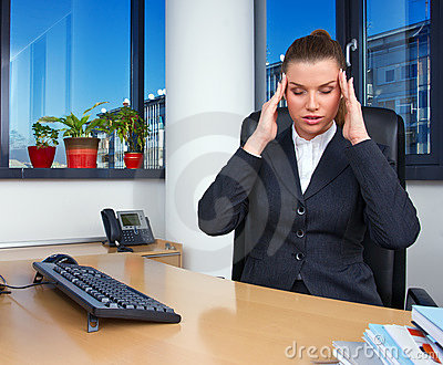 Business woman with migraine