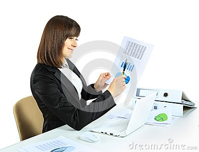 Business woman with notebook in office