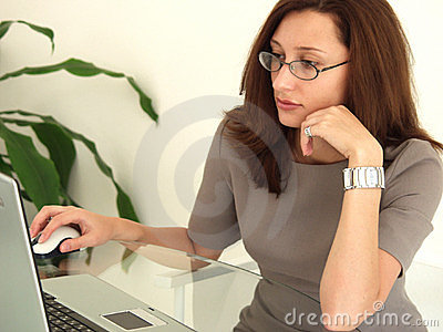 Business Woman at Notebook PC