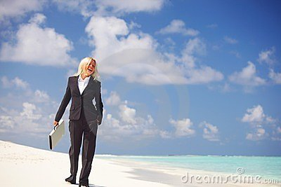 Business woman on the ocean coast