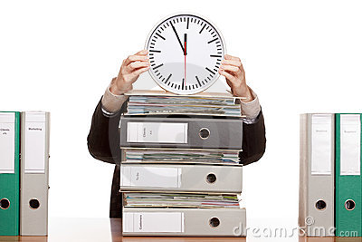 Business woman in office under time pressure