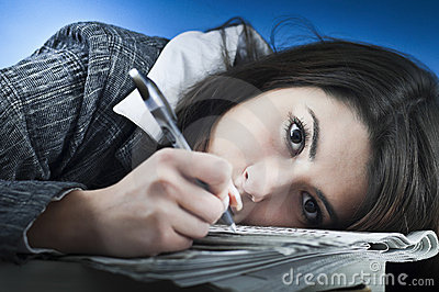 Business woman overwhelmed by paper work