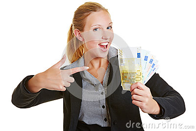 Business woman pointing to Euro money