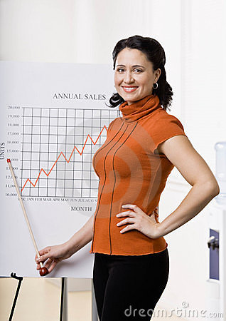 Business woman pointing to sales graph