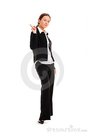Business woman pointing up at copyspace