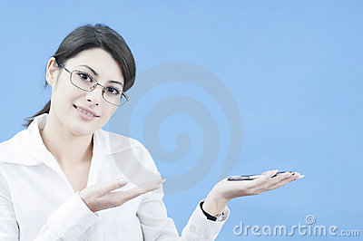 Business woman presenting an object